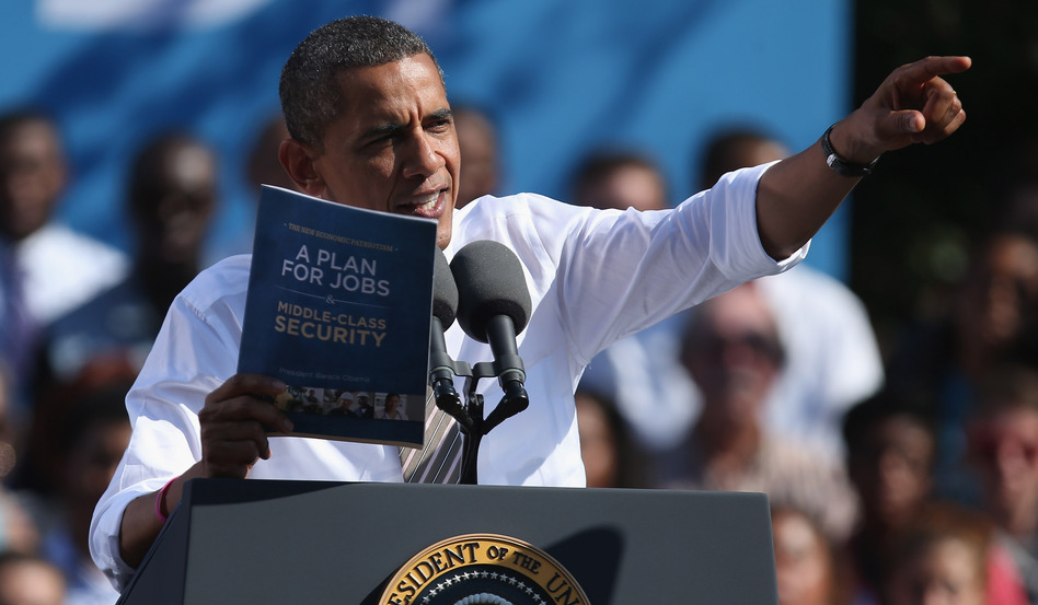 "President Obama holds a copy of ""The New Economic Patriotism: A Plan for Jobs & Middle-Class Security,"" which outlines some of his agenda for a second term, during a rally in Richmond, Va., on Thursday."