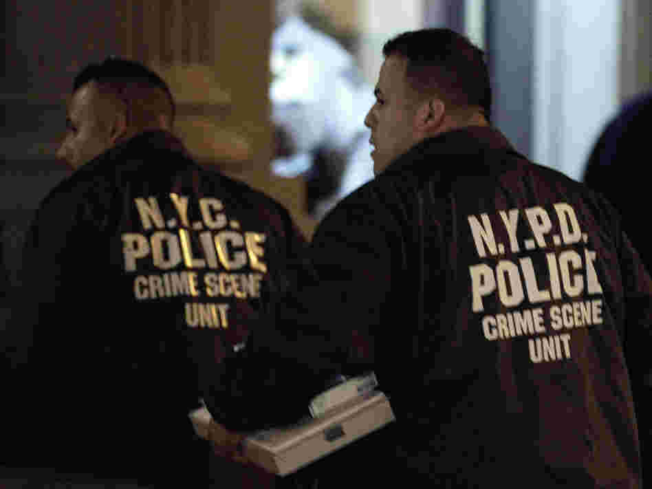 Crime scene unit officers outside the Manhattan apartment building where the children were killed Thursday.