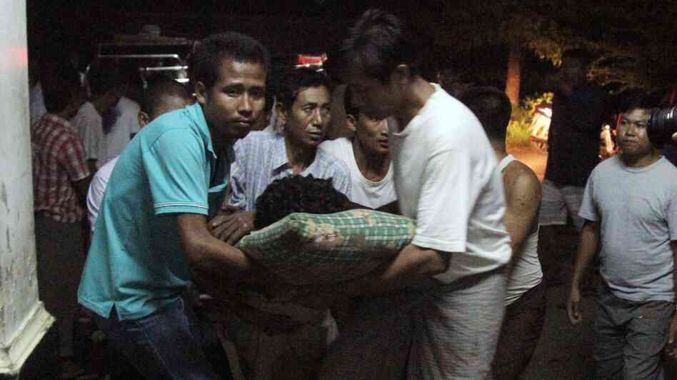 An injured Rakhine Buddhist is taken to the hospital following violence