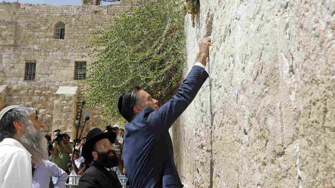 Republican presidential candidate Mitt Romney places a prayer note during a visit to the Western Wall in Jerusalem in July. Israel is one of the few foreign countries where residents have a clear preference for Romney over President Obama.