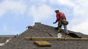 A construction worker finishes a roof in Chicago on