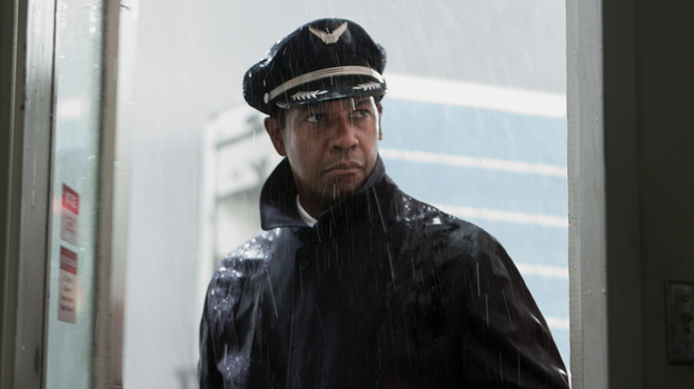 Airline pilot Whip Whitaker (Denzel Washington) is hailed as a hero after averting disaster when his plane malfunctions — but as Flight goes on, it turns out he's anything but a shining example. (Paramount Pictures)