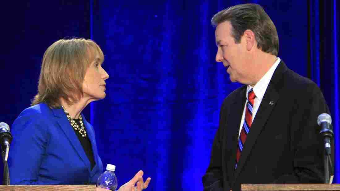 Democrat Maggie Hassan and Republican Ovide Lamontagne talk during a break in their gubernatorial debate in Henniker, N.H., on Oct. 4.