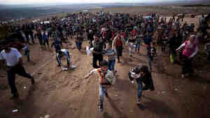 Children run after a truck loaded with presents for Eid Al-Adha in a refugee camp near Atma, Idlib province, Syria. A powerful car bomb exploded in Damascus on Friday and scattered fighting broke out in several areas across Syria, quickly dashing any hopes that a holiday cease-fire would hold.