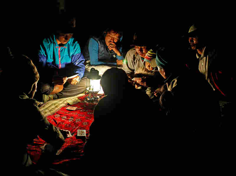 In the afternoon everyone goes back to the campsite. The men drink and play cards for most of the day until late into the night.