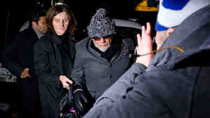 Former British rock star Gary Glitter, whose real name is Paul Gadd, returns home in central London on Sunday after he was arrested earlier in the day by British police as they investigate the mountain of sexual abuse allegations against the late TV star Jimmy Savile.