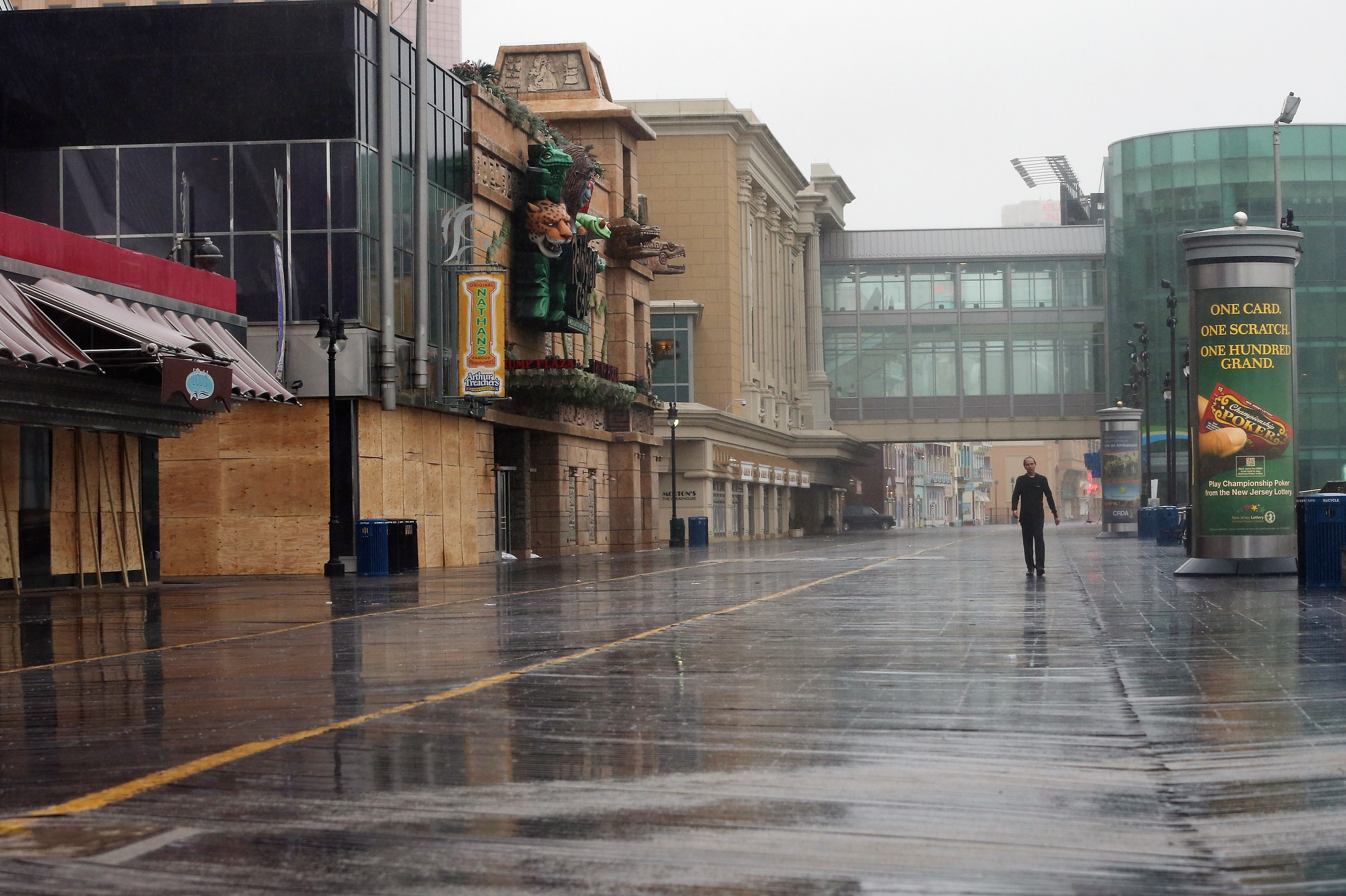 Buildings on the Atlantic City boardwalk are braced for Sandy. Gov. Chris Christie's emergency declaration is shutting down the city's casinos, and 30,000 residents are being told to evacuate.