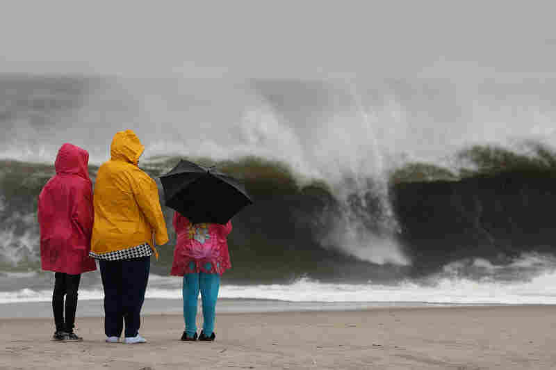 The approaching Hurricane Sandy causes heavy surf in Cape May, N.J., on Sunday. Hurricane Sandy is expected to hit the New Jersey coastline sometime Monday, bringing heavy winds and floodwaters.