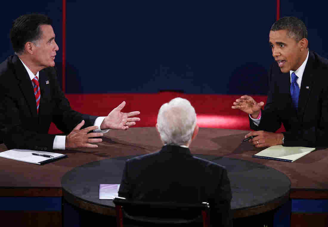 President Barack Obama (R) debates with Republican presidential candidate Mitt Romney (L) as moderator Bob Schieffer listens on Oct. 22, 2012.