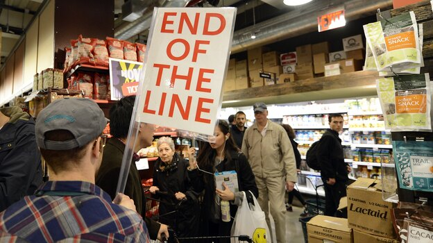 People try to get through the aisles at Whole Foods Market in Midtown in New York on Sunday before the storm. (AFP/Getty Images)