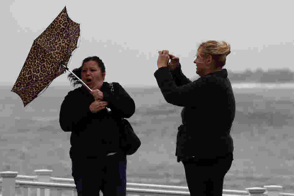 Hurricane Sandy's winds are already picking up in Cape May, N.J. Kim Vo (right) captures a Kodak moment of her friend, Lisa Cellucci.