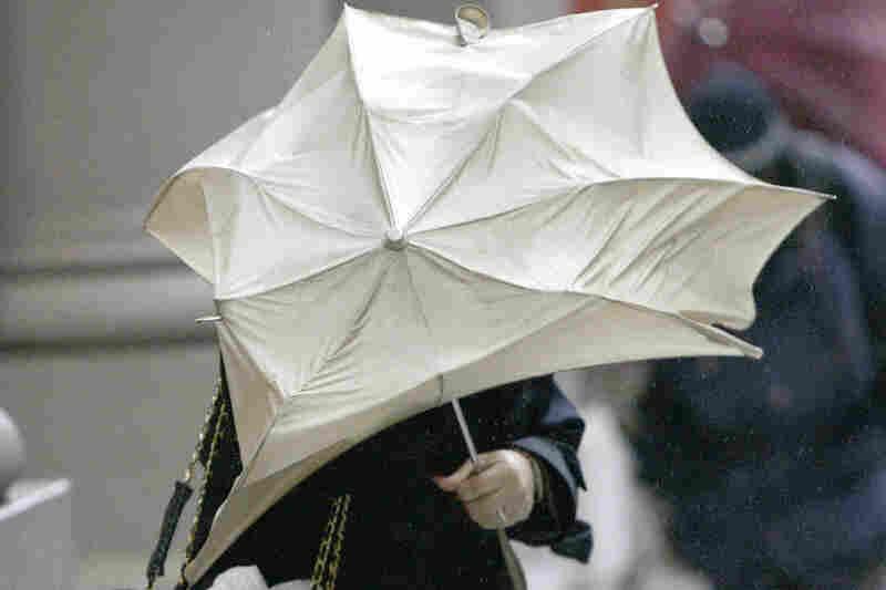 Umbrella attack during Hurricane Wilma in New York City, 2005.