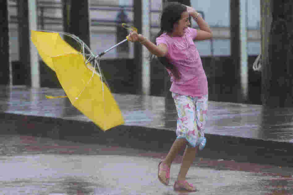 Kayla Mejia of Annapolis, Md., struggles again winds from Hurricane Irene, 2011.