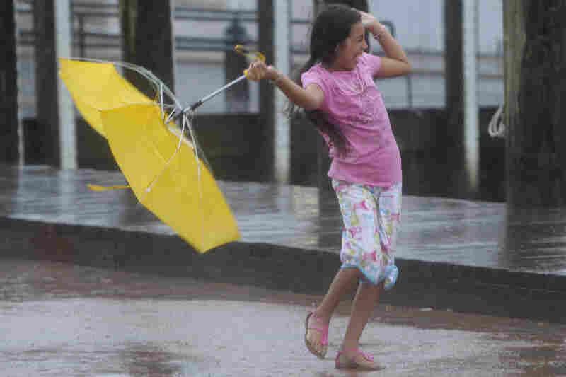 Kayla Mejia of Annapolis, Md., struggles again winds from Hurricane Irene, 2011.