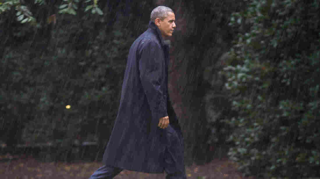 President Obama walks toward the White House on Monday after returning to
