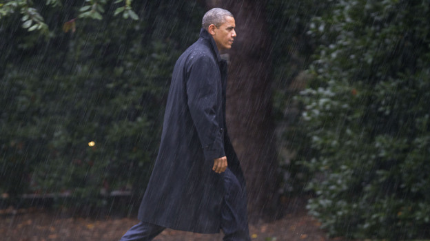 President Obama walks toward the White House on Monday after returning to Washington to monitor the government response to Hurricane Sandy. (AP)