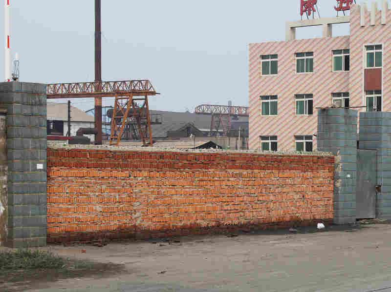 China faces overcapacity in various industries, including steel. This steel mill in the northern city of Tangshan went bankrupt in August after it expanded too quickly and the boss ending up owing banks more than $120 million. Authorities sealed the front gate with bricks.