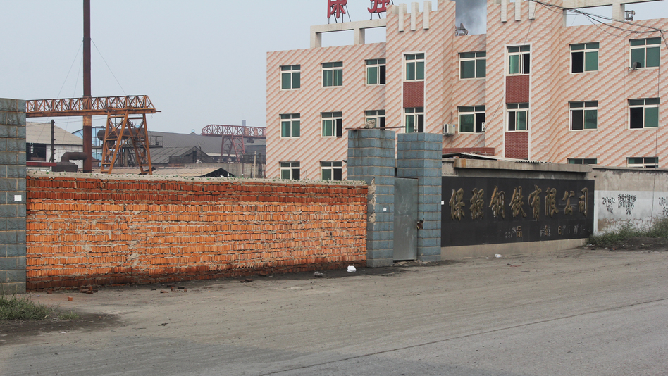 China faces overcapacity in various industries, including steel. This steel mill in the northern city of Tangshan went bankrupt in August after it expanded too quickly and the boss ending up owing banks more than $120 million. Authorities sealed the front gate with bricks. (NPR)