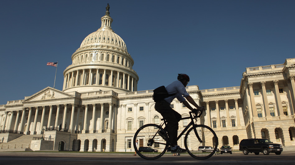 A bicyclist rides through the plaza on the east side of the U.S. Capitol in Washington, D.C. (Getty Images)