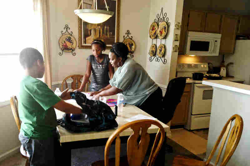 Johnita Ellerby, a single mother of four, is studying social work while working full time. She fears her progress could be erased if she loses her scholarship.