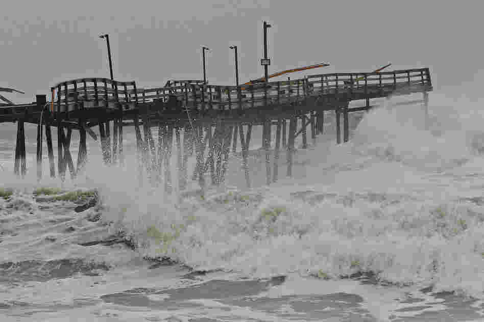 Waves crash onto the damaged Avalon Pier in Kill Devil Hills, N.C., as the hurricane churns up the East Coast. Sandy is sending coastal residents fleeing as it threatens a dangerous mix of high winds and soaking rain.
