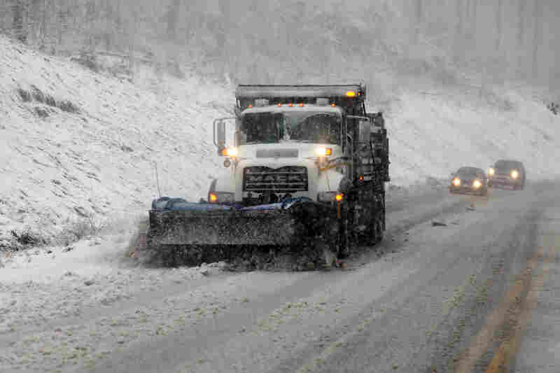 Snowplows move through Randolph County, W.Va. Sandy was set to collide with a wintry storm from the west and cold air streaming down from the Arctic.