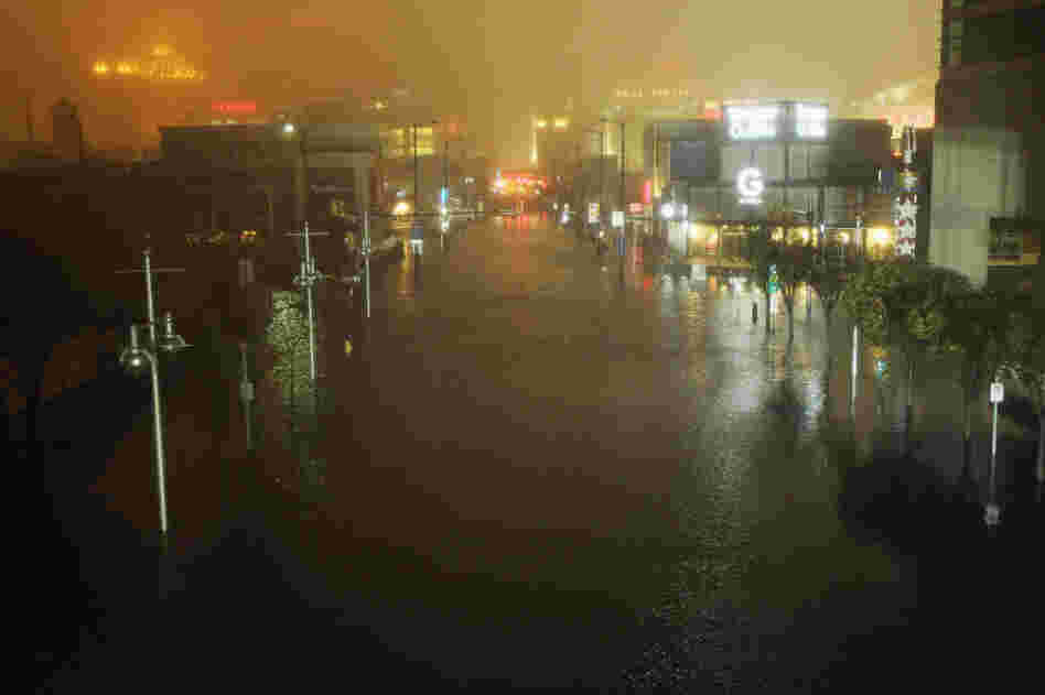 A flooded street is seen at nightfall during rains from Hurricane Sandy in Atlantic City, N.J., on Monday. The New York Times reports that 70 to 80 percent of Atlantic City was underwater.