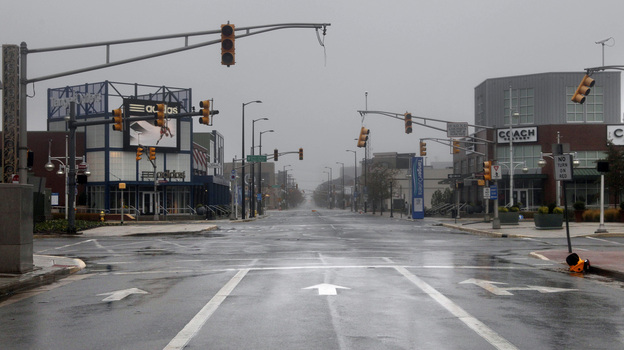 Broken and non-functional traffic lights hang over an intersection in Atlantic City, N.J., on Monday. (AP)