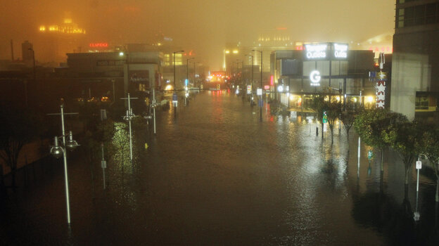 A flooded street is seen at nightfall during rains from Hurricane Sandy in Atlantic City, N.J. on Monday. Sandy made landfall over Southern New Jersey today.