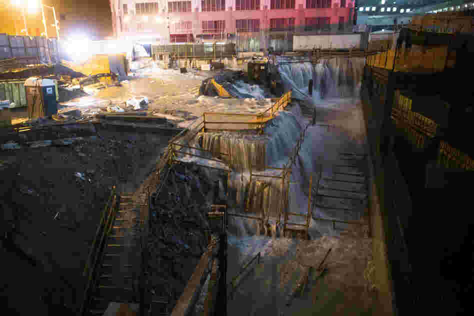 Seawater floods the ground zero construction site in New York City. The storm, which has spread rain and high winds from North Carolina to New England and west into Pennsylvania and upstate New York, continues to head northwest.