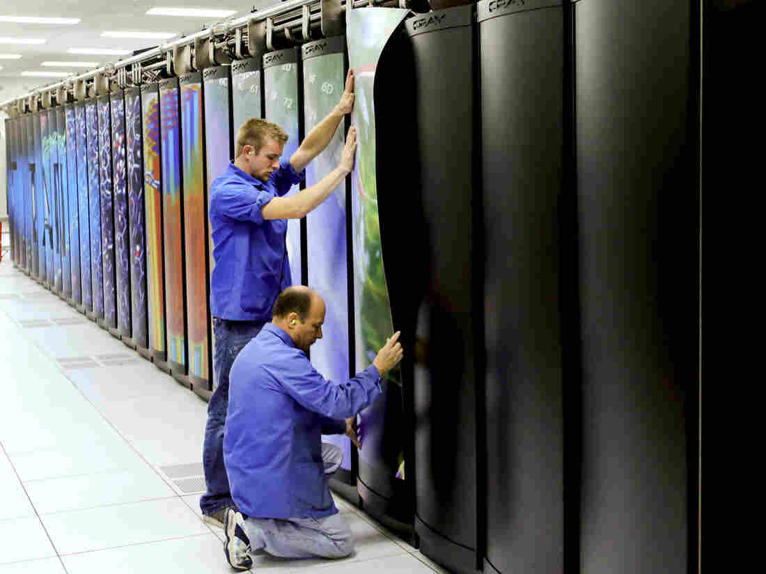 Cray employees put the finishing touches on Titan at the Department of Energy