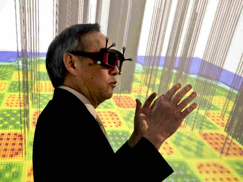 "U.S. Energy Secretary Chu stands inside a 3-D imaging ""cave,"" which simulates the inside of a nuclear reactor. The cave, powered by the supercomputers at Oak Ridge National Laboratory, helps scientists to process, view and understand enormous amounts of data visually."