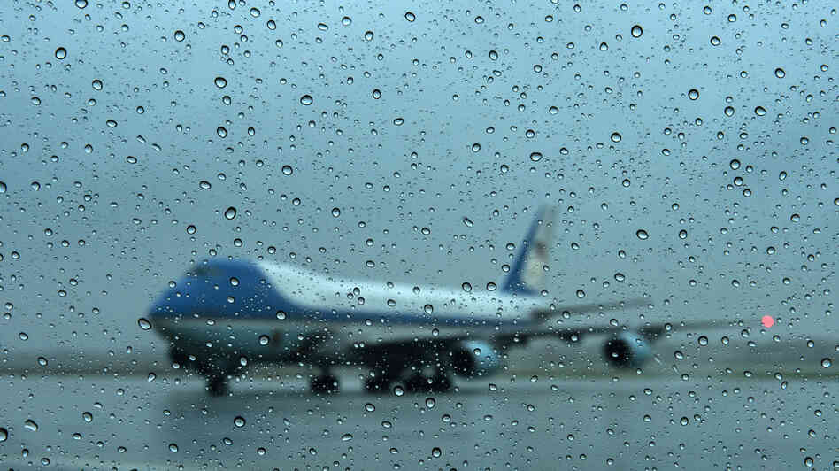 Air Force One arrives at Andrews Air Force Base in Maryland on Monday. President Obama returned from campaigning to monitor the storm.
