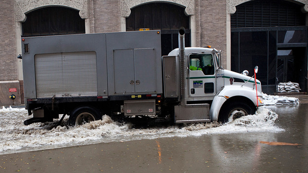 A truck drives through a flooded street caused by Hurricane Sandy in New York City's Financial District on Tuesday. (Getty Images)