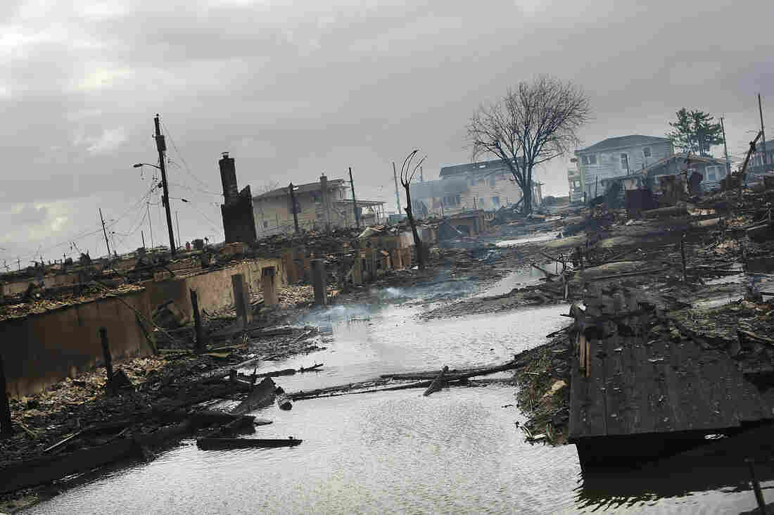 Homes sit smoldering after Hurricane Sandy on Tuesday in the Breezy Point Neighborhood of the Queens.