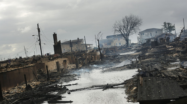 Homes sit smoldering after Hurricane Sandy on Tuesday in the Breezy Point Neighborhood of the Queens. (Getty Images)