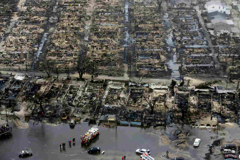 An aerial image of the burned-out homes of the Breezy Point, N.Y. After Sandy, fire and floodwaters transformed this quaint corner of the Rockaways into a smoke-filled debris field.