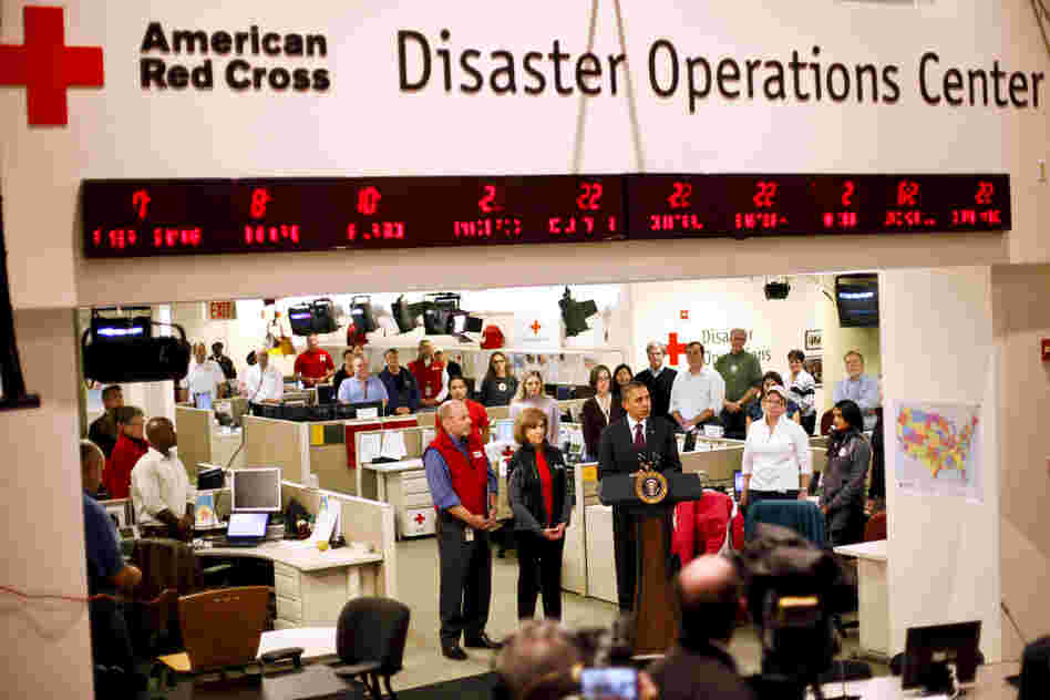 "President Barack Obama visits the Red Cross Disaster Operation Center in Washington. He has declared New York and New Jersey ""federal disaster areas."""