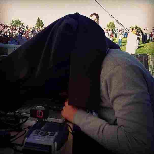 Reporting From the Campaign Trail: NPR Correspondent Ari Shapiro covers his head with a coat to block out noise and distraction as he talks with Host Audie Cornish on All Things Considered. http://bit.ly/RxHc6r