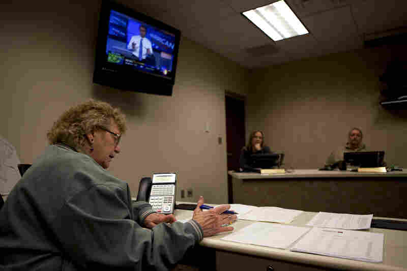 Marty Agee, director of the Raleigh County Emergency Operations Center, holds a conference call to make emergency plans for Sandy's arrival in the town of Beckley, W. Va., on Oct. 29.