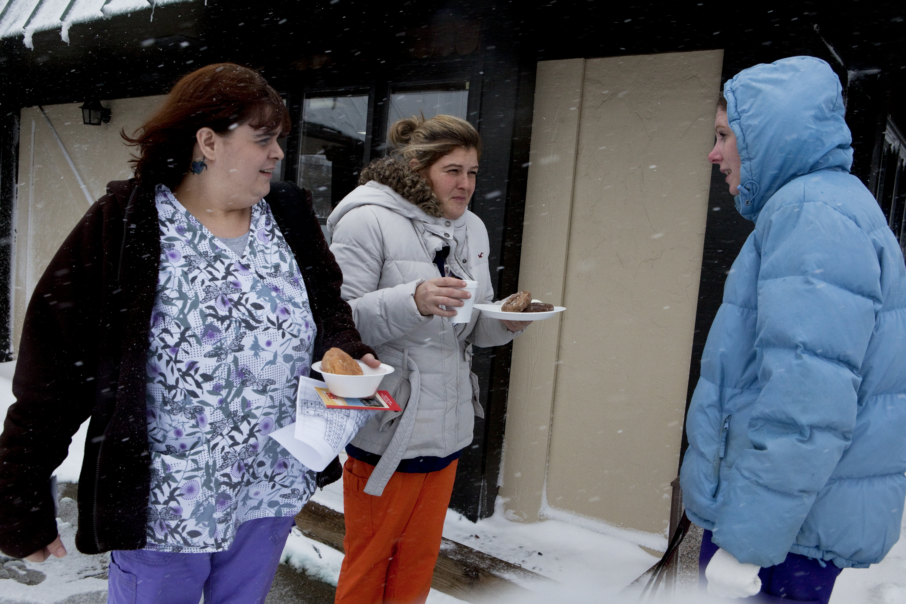 Tabatha Whitt, Hollie Acora and Erin Dowman, nurses at Raleigh General Hospital in Beckley, talk outside of a hotel where they stayed overnight to avoid driving in the heavy snow.