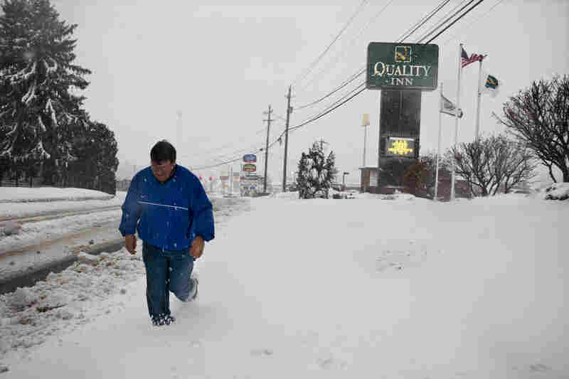 Todd Sargent, a resident of Beckley, heads out into the snow to distribute generators.
