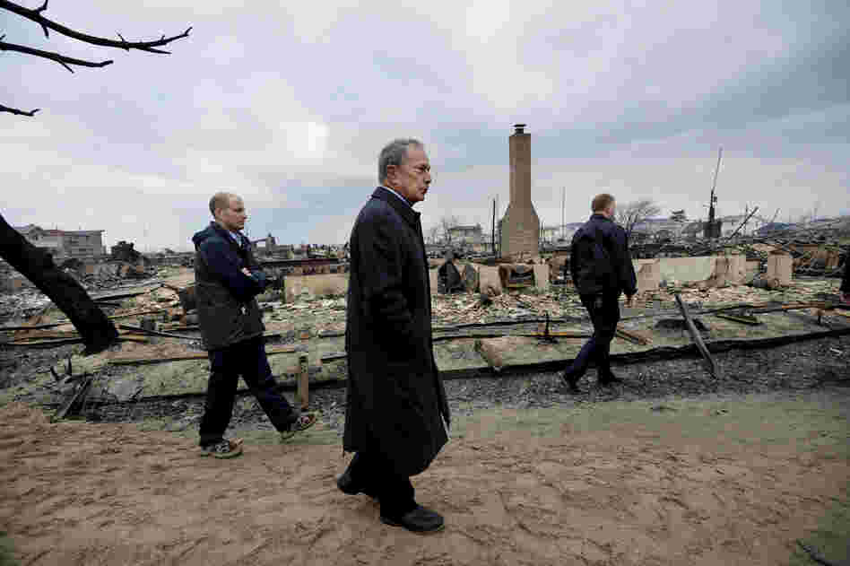 New York City Mayor Michael Bloomberg (center) views damage in the Breezy Point area of Queens, N.Y. Estimates of the damage caused by superstorm Sandy — including interruption of business activity and impact on infrastructure — range from $30 billion to $50 billion.