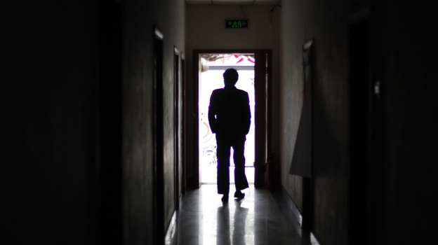 "A man walks through a former unofficial, or ""black,"" jail in Beijing, in 2009. It's estimated that thousands of Chinese lodging protests against the government are illegally detained in secret sites such as this one, even though the government says they don't exist. (AP)"