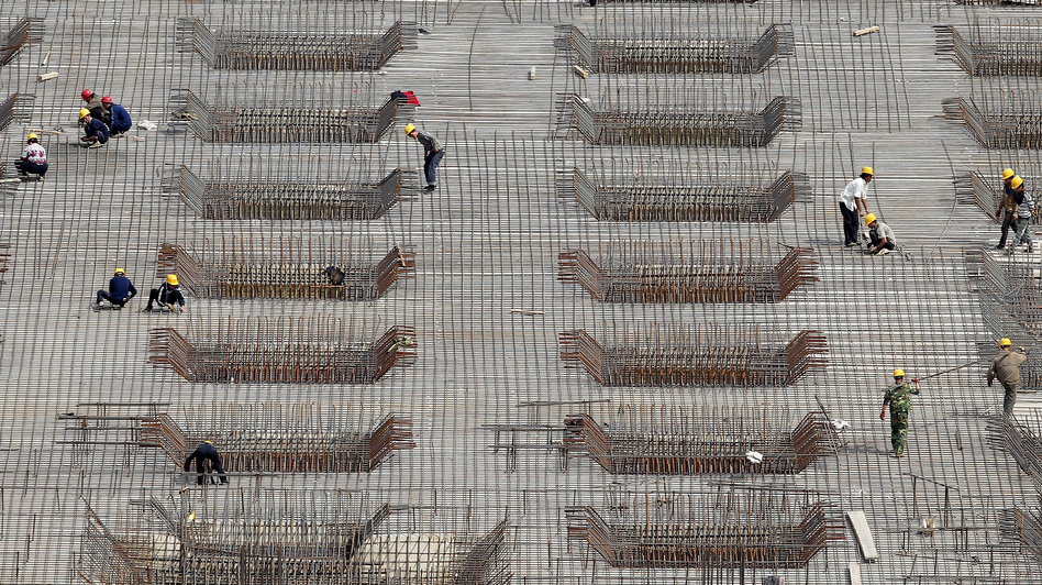 China's rapid expansion has been fueled in part by massive construction projects, like this one in Beijing, shown last year. But many economists say the Chinese economic model is unlikely to produce the same explosive growth in the coming years and needs to be revamped. (Getty Images)