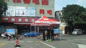 Police stand on watch on the streets of Shaxi, China, following three days of riots in June.