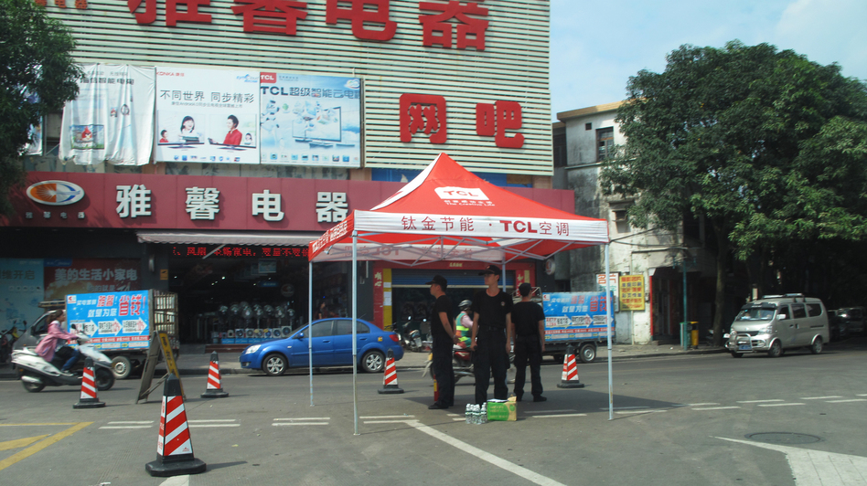 Police stand on watch on the streets of Shaxi, China, following three days of riots in June. (NPR)