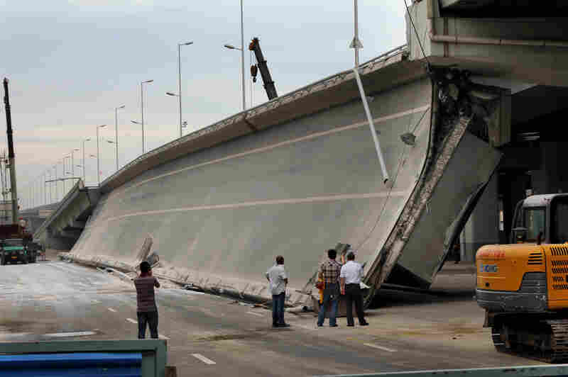 Eight bridges have collapsed around China since 2011. Here, government investigators examine a recently built entrance ramp that collapsed this summer in the northeastern city of Harbin, killing three people. Local residents believe government corruption and substandard materials are to blame.