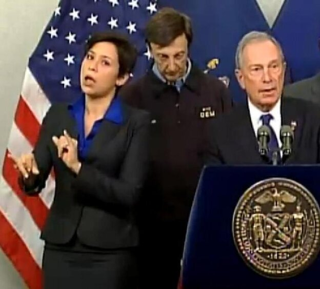 Fans like her style: Mayor Michael Bloomberg (at right) briefing New Yorkers about Hurricane Sandy on Monday. At left is his sign language interpreter, who the mayor identified as Lydia Callis.