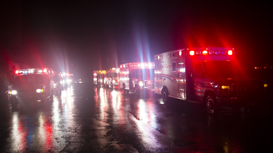 Ambulances line up outside New York University Langone Medical Center to evacuate patients after backup generators failed when Sandy knocked out power in Lower Manhattan Monday. (AP)